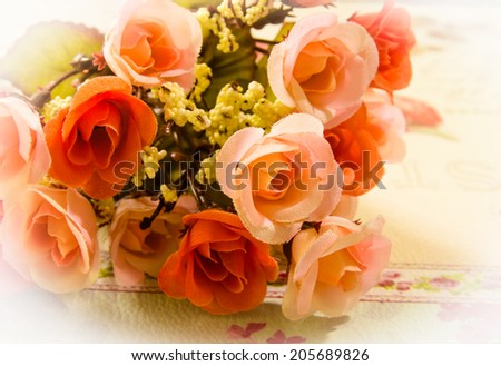 Close up of artificial flower bouquet,pink and orange rose