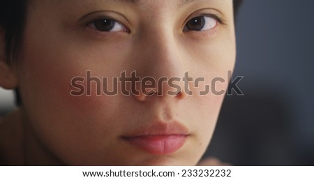 Close up of Asian woman's face - stock photo