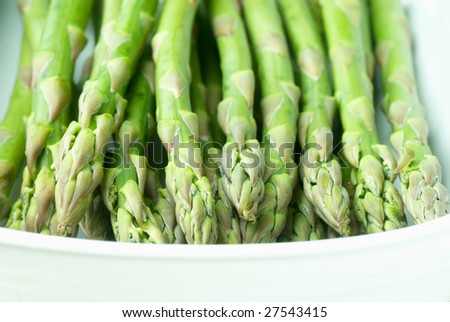 Close up of asparagus spears in a white bowl - stock photo