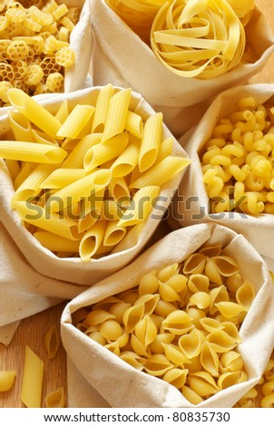 Close-up of assorted pasta in jute bags. - stock photo