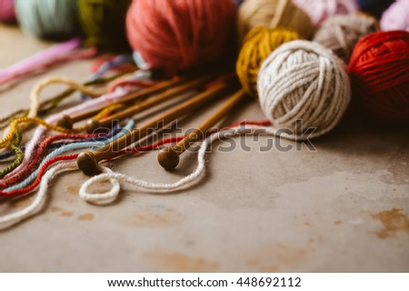 Close up of assorted yarn and wooden needles - stock photo