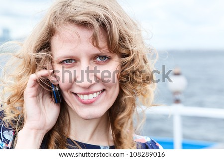 Close up of attractive Caucasian woman with mobile phone. Copyspace