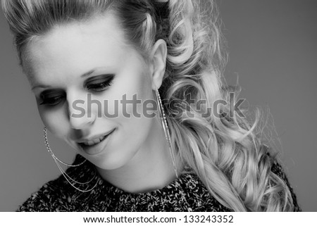 Close up of attractive smiling girl, black and white image, horizon format