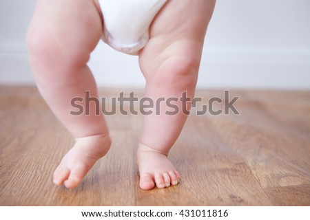 close up of baby feet doing the first steps