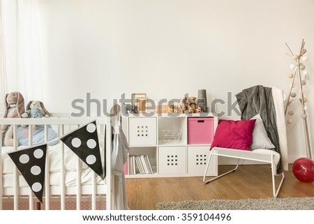 Close-up of baby furniture in girl's room