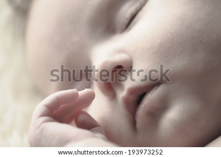 Close up of baby girls' sweet little head and face - stock photo