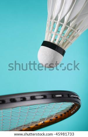 close up of badminton shuttlecock and racquet - stock photo