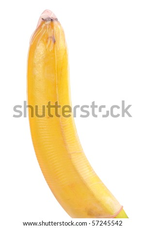 Close-up of banana with red condom isolated on white