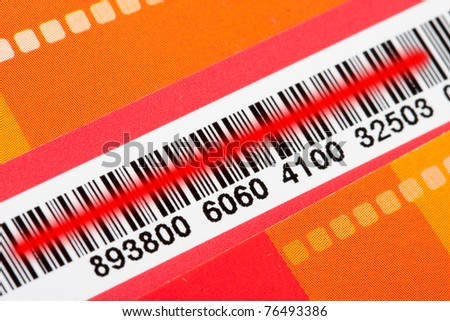 Close-up of bar code with red scanner laser - stock photo