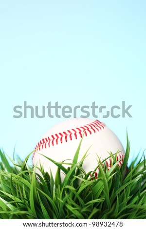 Close up of baseball in grass