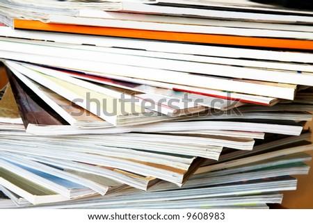 Close- up of batch of magazines - stock photo