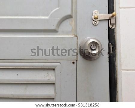 Aluminum Door Knob On White Door Stock Photo 208283302