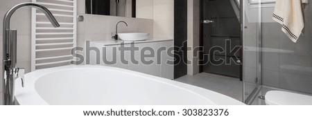 Close-up of bathtub in luxury modern bathroom - stock photo