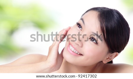 Close up of beautiful asian woman face with green background - stock photo