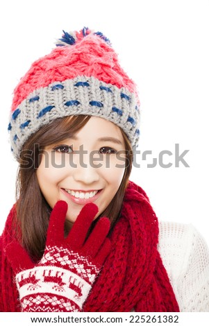 close up of beautiful asian woman in hat, muffler and mittens. happiness concept