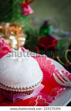 Close-up of beautiful cupcake for christmas, decorated with white sugar paste. Selective focus. - stock photo
