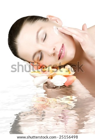 Close-up of beautiful face in water - stock photo