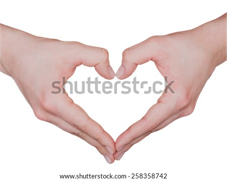 Close up of beautiful female hands form heart shape isolated on white background