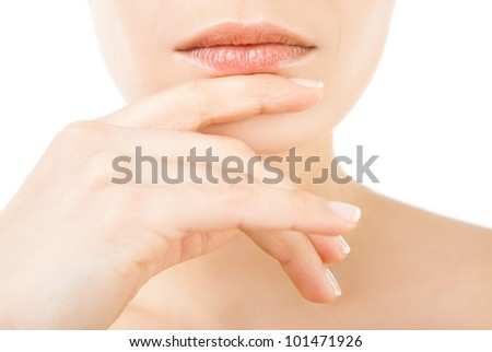 Close-up of beautiful female lips and hand on chin