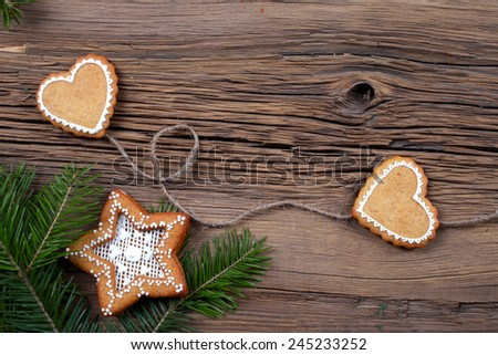 close-up of beautiful festive Christmas still life of the branches of spruce, cookies and spice on wood background with cracks studio