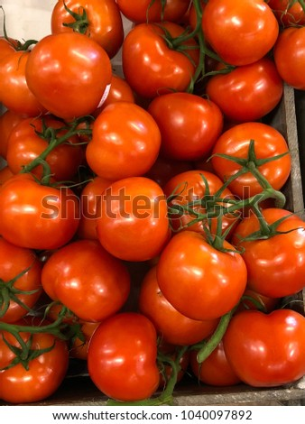 Close up of beautiful fresh red tomatoes for sale in a supermarket