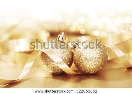 Close-up of beautiful golden glitter christmas decorative balls - stock photo