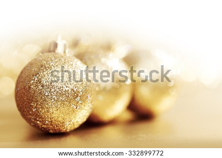 Close-up of beautiful golden glitter christmas decorative balls - stock photo