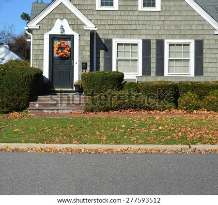 Close up of Beautiful Home Leaf wreath Sunny autumn day residential neighborhood USA