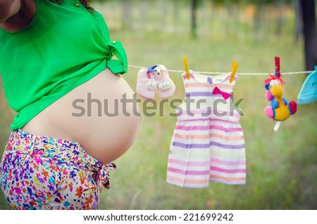 Close up of beautiful pregnant belly - stock photo