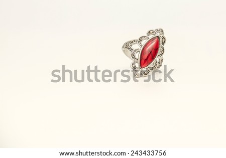 Close up of beautiful red stone silver ring with diamond for gift or present for special someone - stock photo