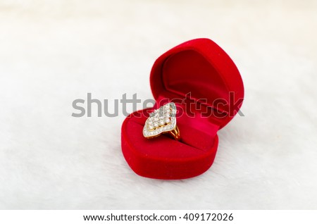 Close up of beautiful ring in velvet red box on white carpet background, Valentine's day, love concept, marry me - stock photo