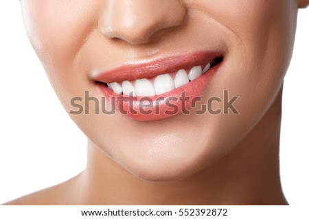 Close up of beautiful wide smile of young fresh woman with great healthy white teeth. Isolated over white background