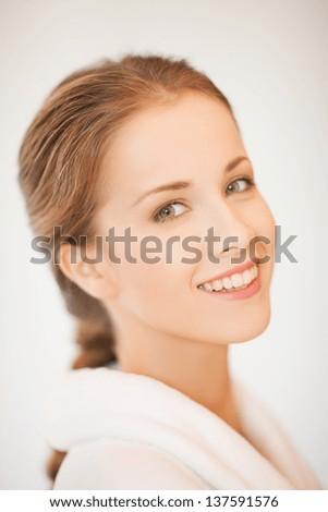 close up of beautiful woman in bathrobe - stock photo