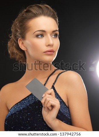 close up of beautiful woman in evening dress with small bag - stock photo