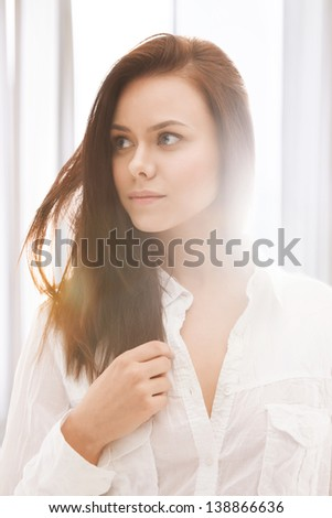 close up of beautiful woman in sunlight