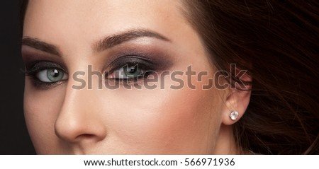Close up of beautiful woman's eyes with makeup