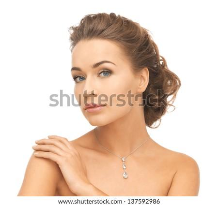 close-up of beautiful woman wearing shiny diamond necklace - stock photo