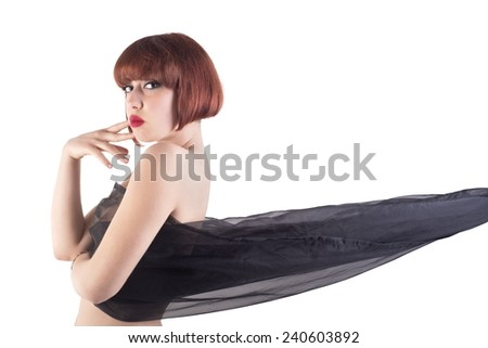 Close-up Of Beautiful Young Woman Wrapped In Black Cloth - stock photo
