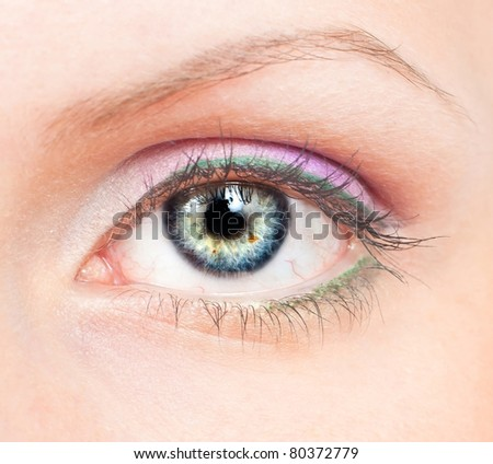 Close-up of beauty female eye with pink and green make-up - stock photo