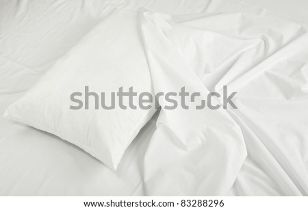 close up of bedding sheets and pillow - stock photo