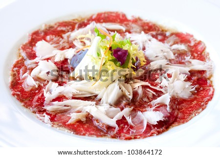 Close up of beef carpaccio with parmesan cheese flocks. - stock photo