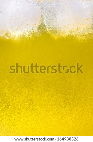 Close-up of beer and ice cube - stock photo