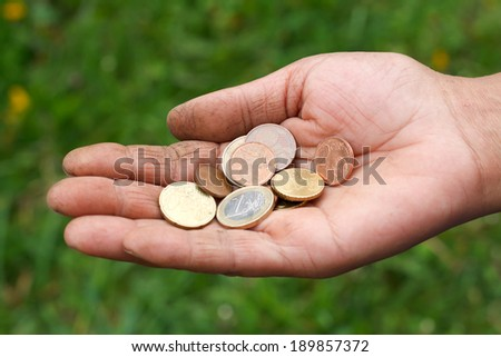 Close up of beggar gipsy hands - stock photo