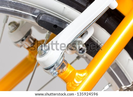 Close up of bicycle brakes. - stock photo