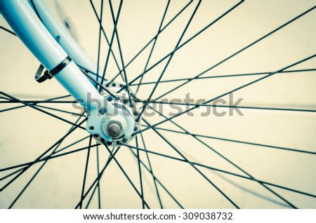 close up of bicycle wheels process in vintage retro style - stock photo