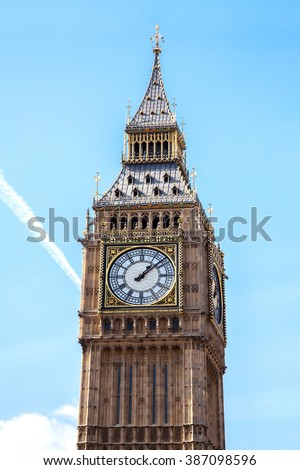 Close up of Big Ben Clock Tower Against Blue Sky England United Kingdom - stock photo