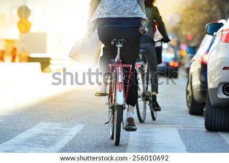 Close up of bike and bicyclist in traffic