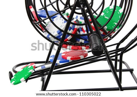Close Up of Bingo Game Cage with Poker Chips - stock photo