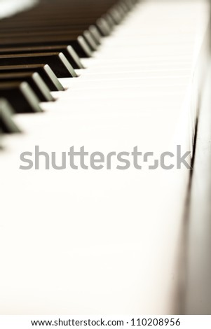 Close up of black and white keys of a piano - stock photo