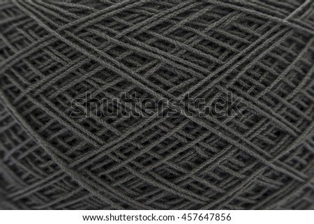 Close up of black ball of wool yarn and knitting needles. Handcraft equipment used for needlework as a hobby. - stock photo